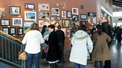 Crowds view the exhibit prior to the Awards Ceremony